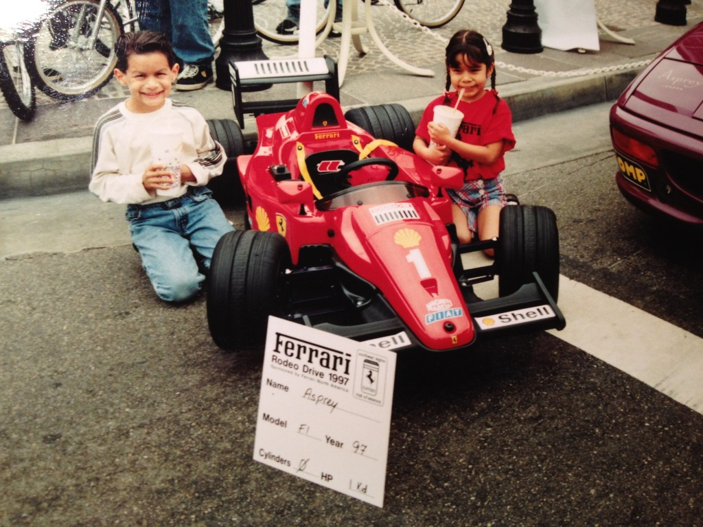 1997 Rodeo Drive Concours d'Elegance - Andrew & Cat with a Ferrari F1 kid racer. © 1997 Victor Varela